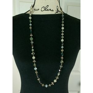 Single strand beaded necklace on silver tone chain